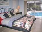 2923.tn-vacation_homes_in_marco_island_house_rental_-_king_bed_in_master_bedroom_wmaster_bath_roll_out_of_bed_and_into_the_pool_.jpg