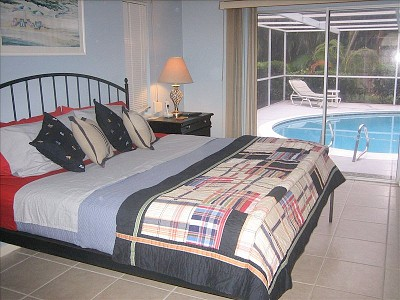 2923.vacation_homes_in_marco_island_house_rental_-_king_bed_in_master_bedroom_wmaster_bath_roll_out_of_bed_and_into_the_pool_.jpg