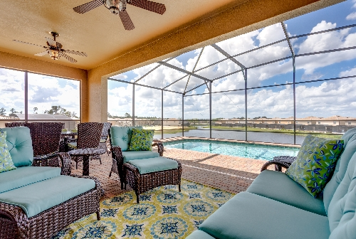 3213.pool deck with covered lanai comfy seating overlooking pond.JPG